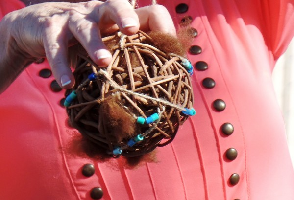 Ball to hang in a tree to give birds fleece for their nests