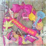 Summer Fun Beach Towel Wreath - Upcycle a beach towel and old summer toys into a fun summer themed wreath.