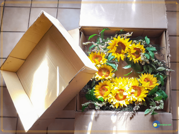 sunflower wreath in packing box